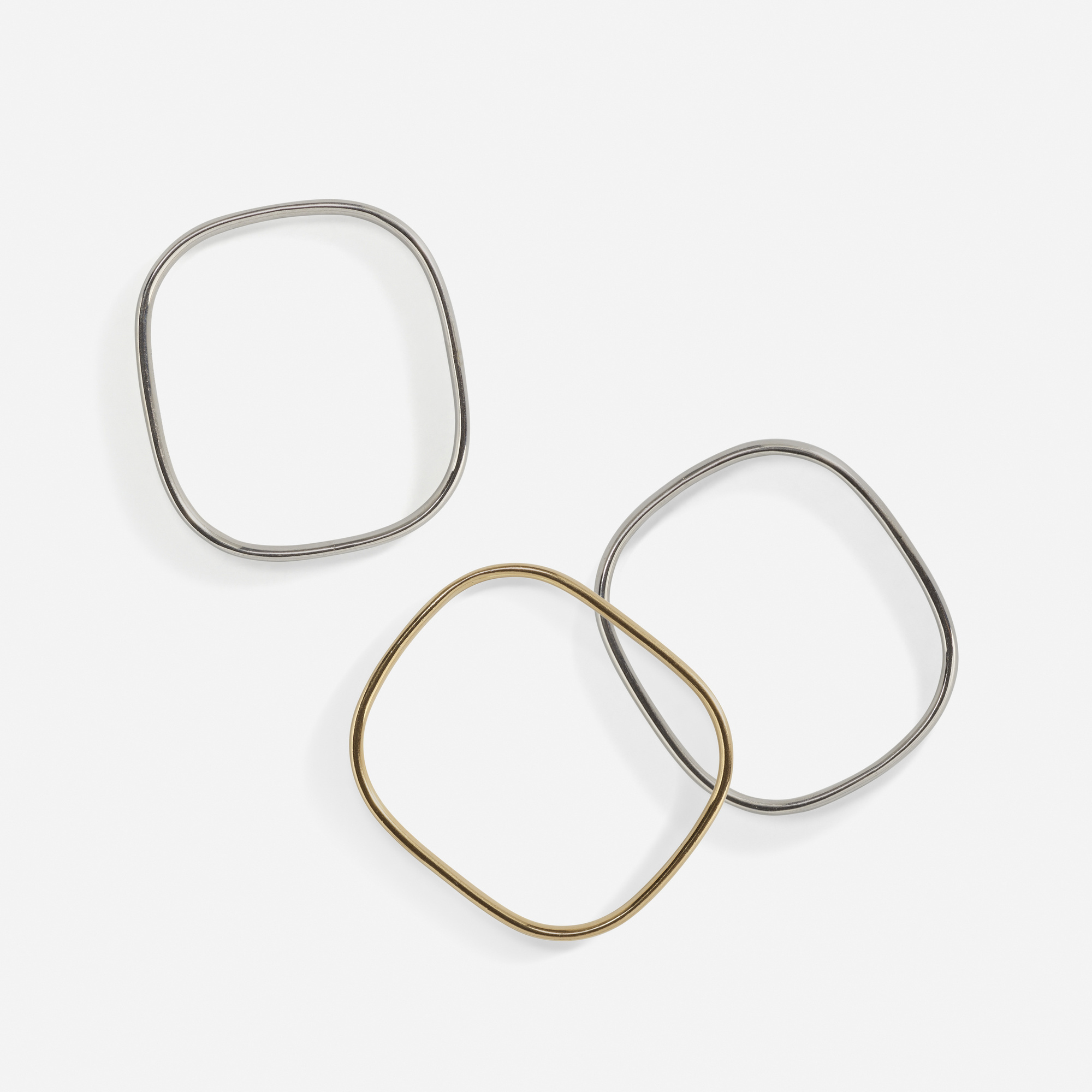 101: Jean Dinh Van for Cartier / A set of three gold bangles (1 of 2)
