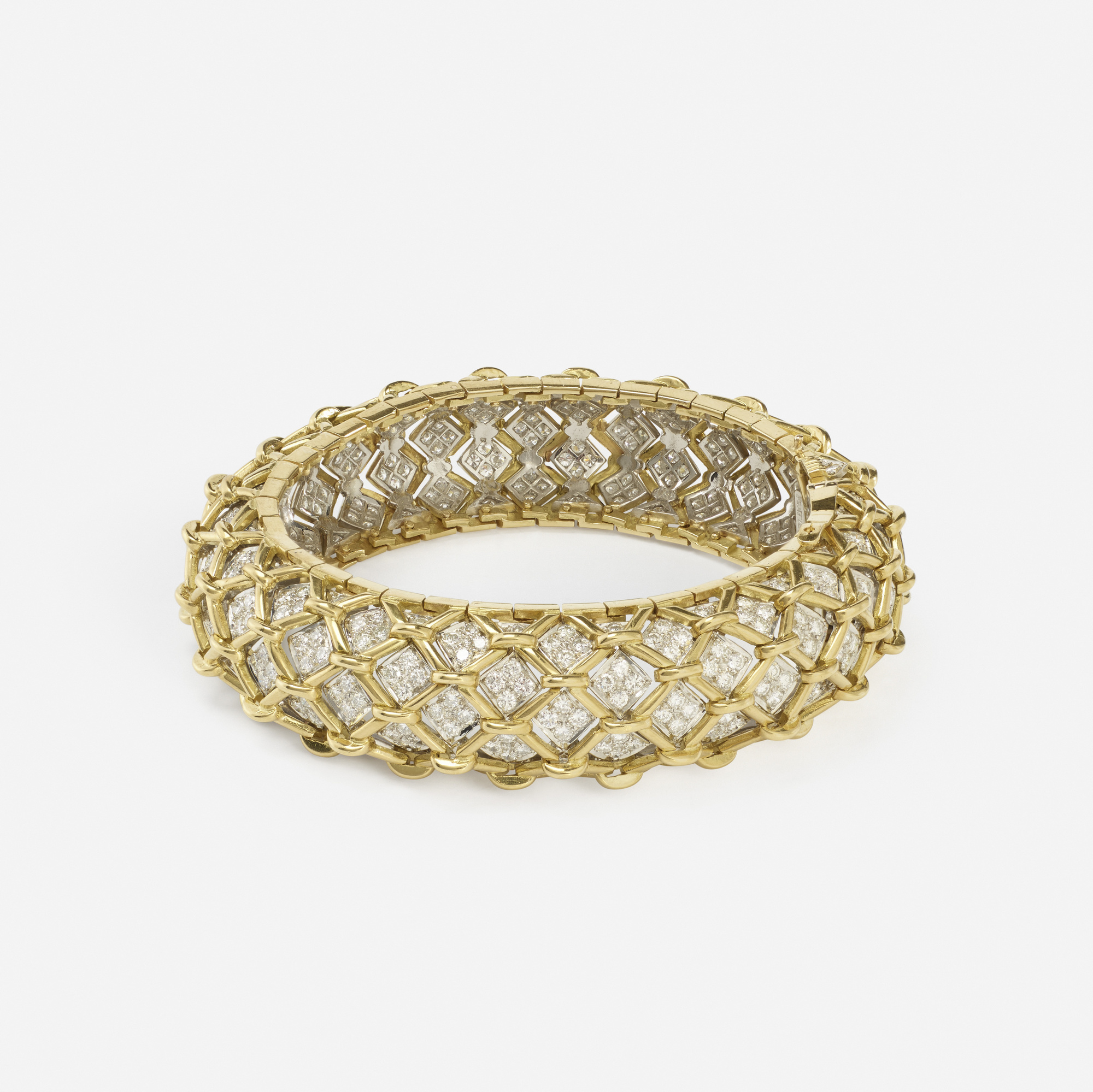 103:  / A gold, platinum and diamond bracelet (1 of 2)