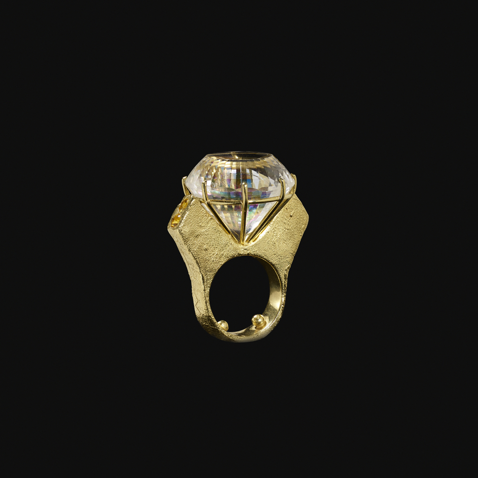 107:  / A gold and white topaz ring (2 of 2)