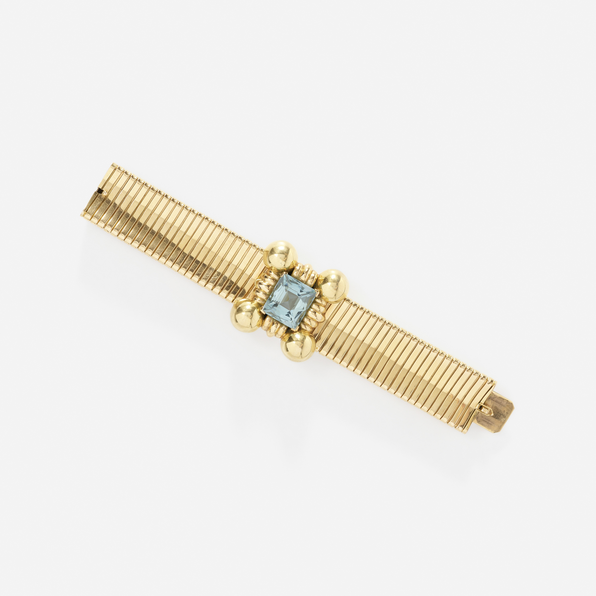 109:  / A gold and aquamarine bracelet (1 of 2)