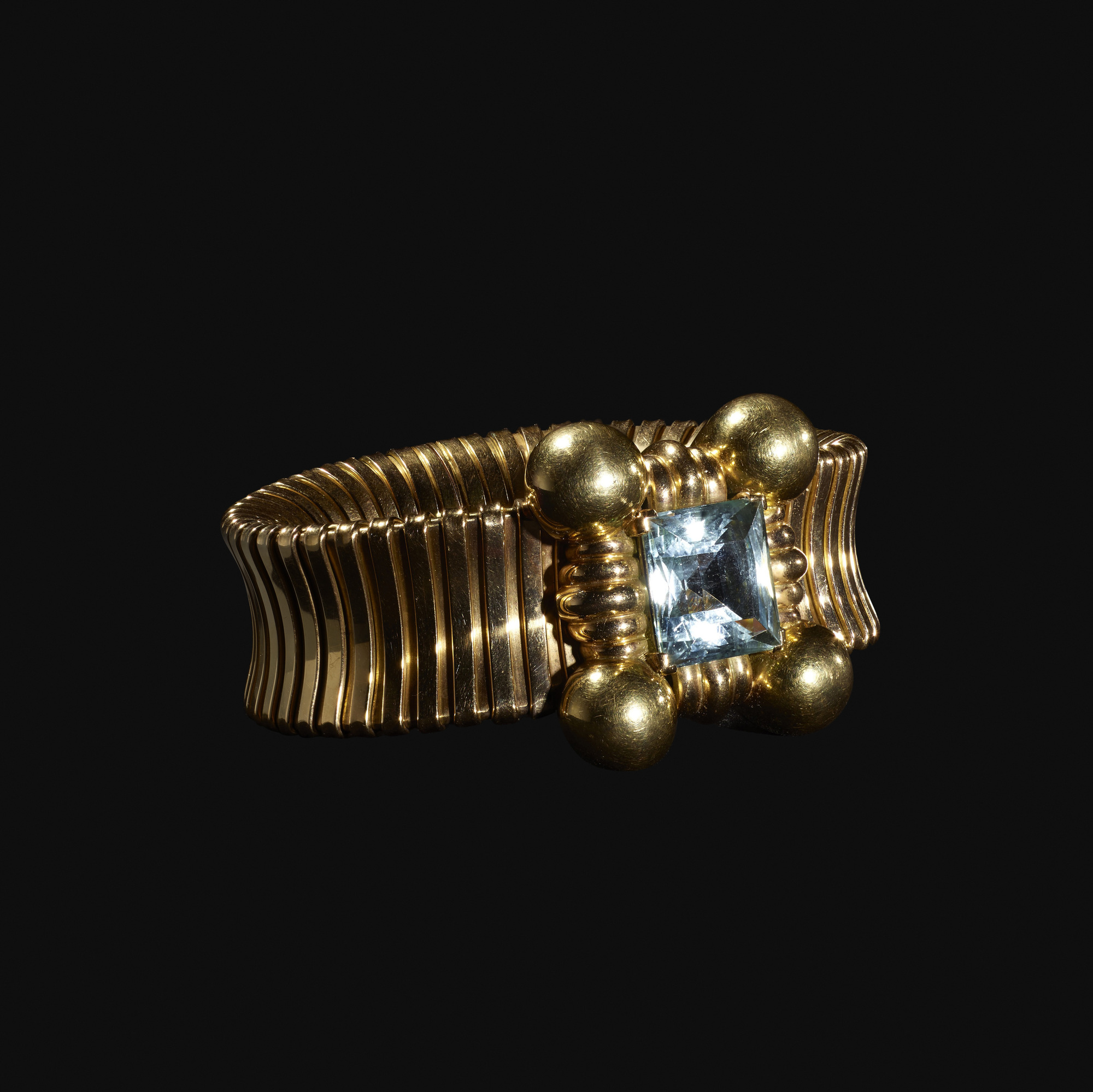 109:  / A gold and aquamarine bracelet (2 of 2)