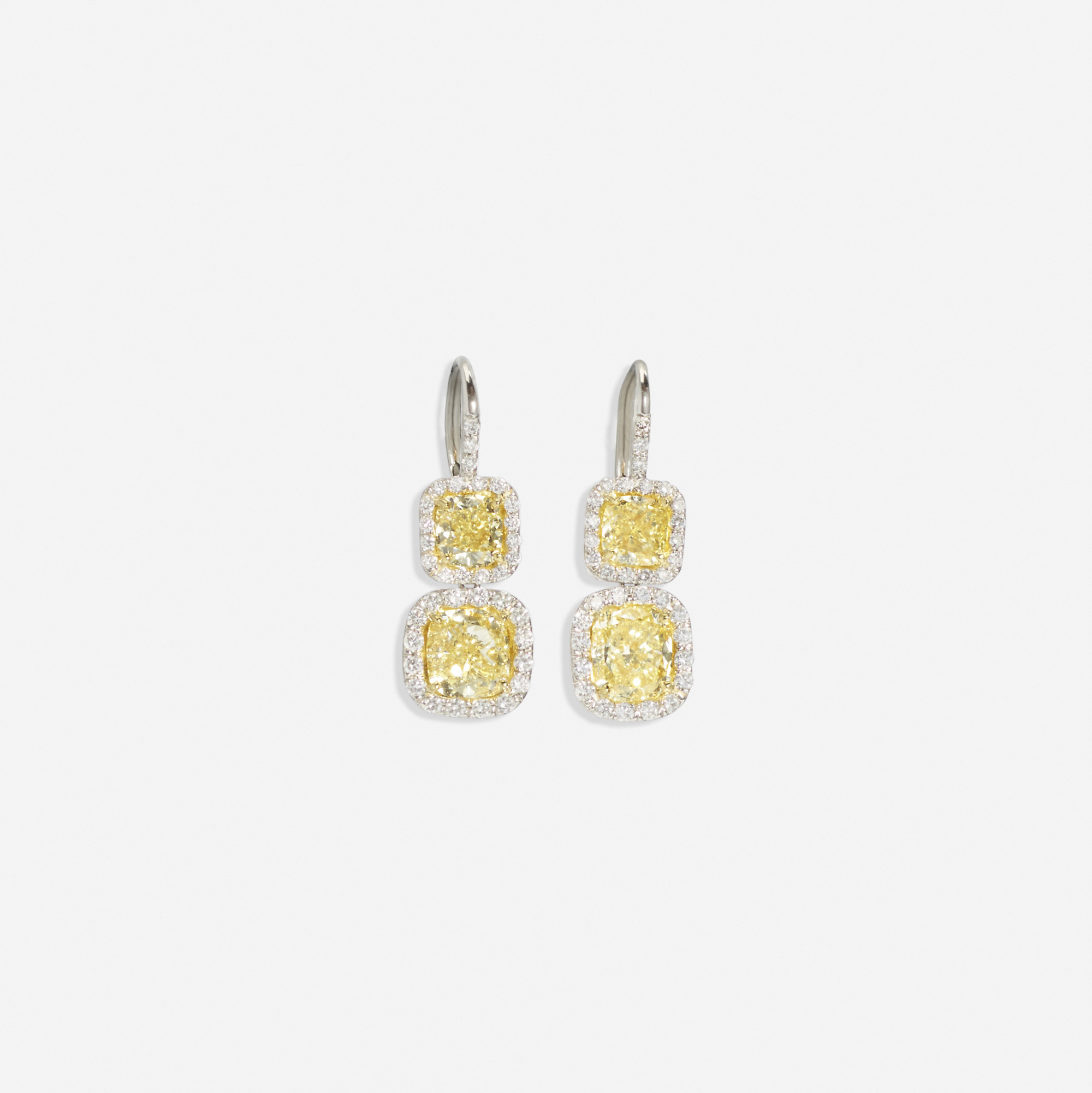 117:  / A pair of platinum, gold and yellow diamond earrings (1 of 1)