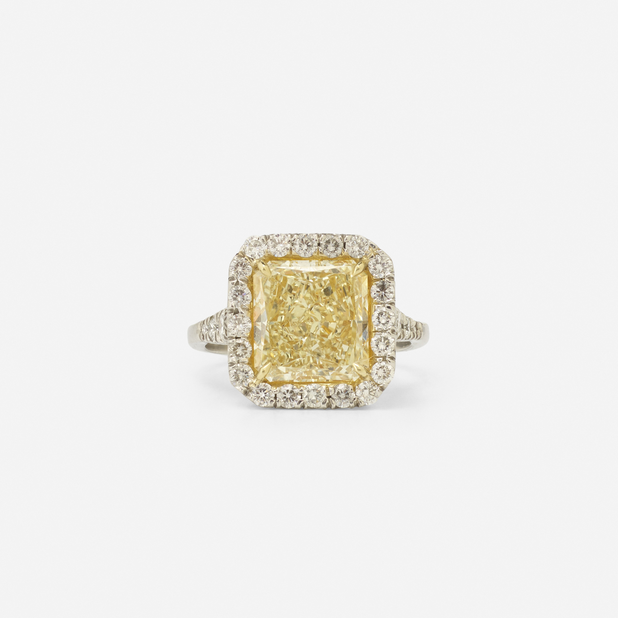 118:  / A platinum, gold and yellow diamond ring (1 of 2)