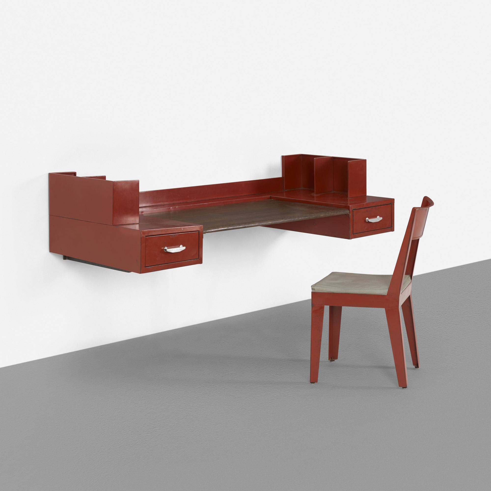 129: JEAN PROUVÉ AND JULES LELEU, wall-mounted desk and chair for ...