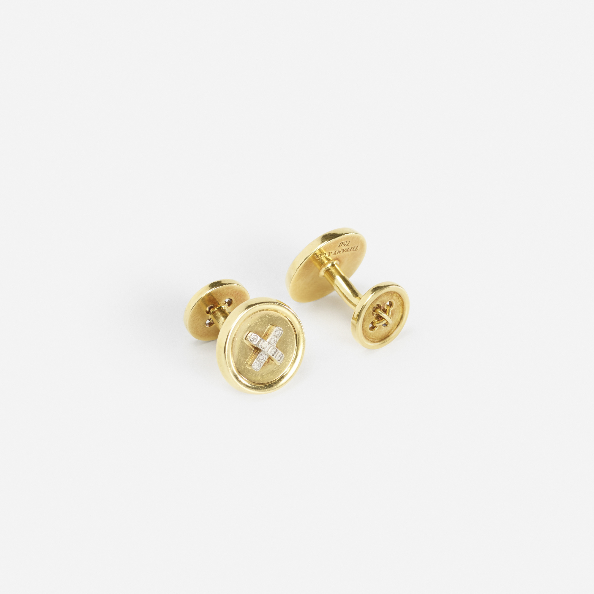 153: Tiffany & Co. / A pair of gold and diamond Button cufflinks (1 of 1)