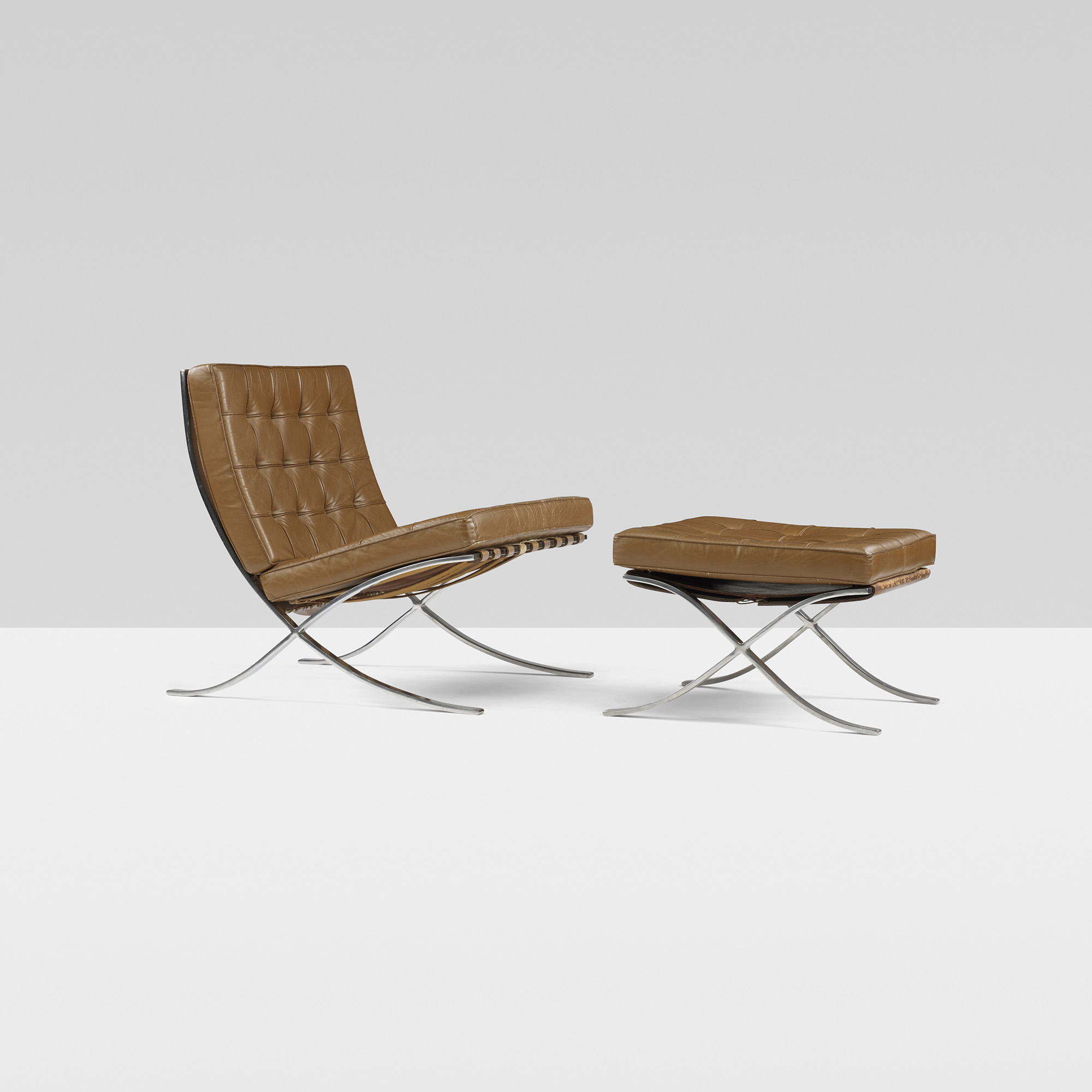 155 Ludwig Mies van der Rohe pair of Barcelona chair and