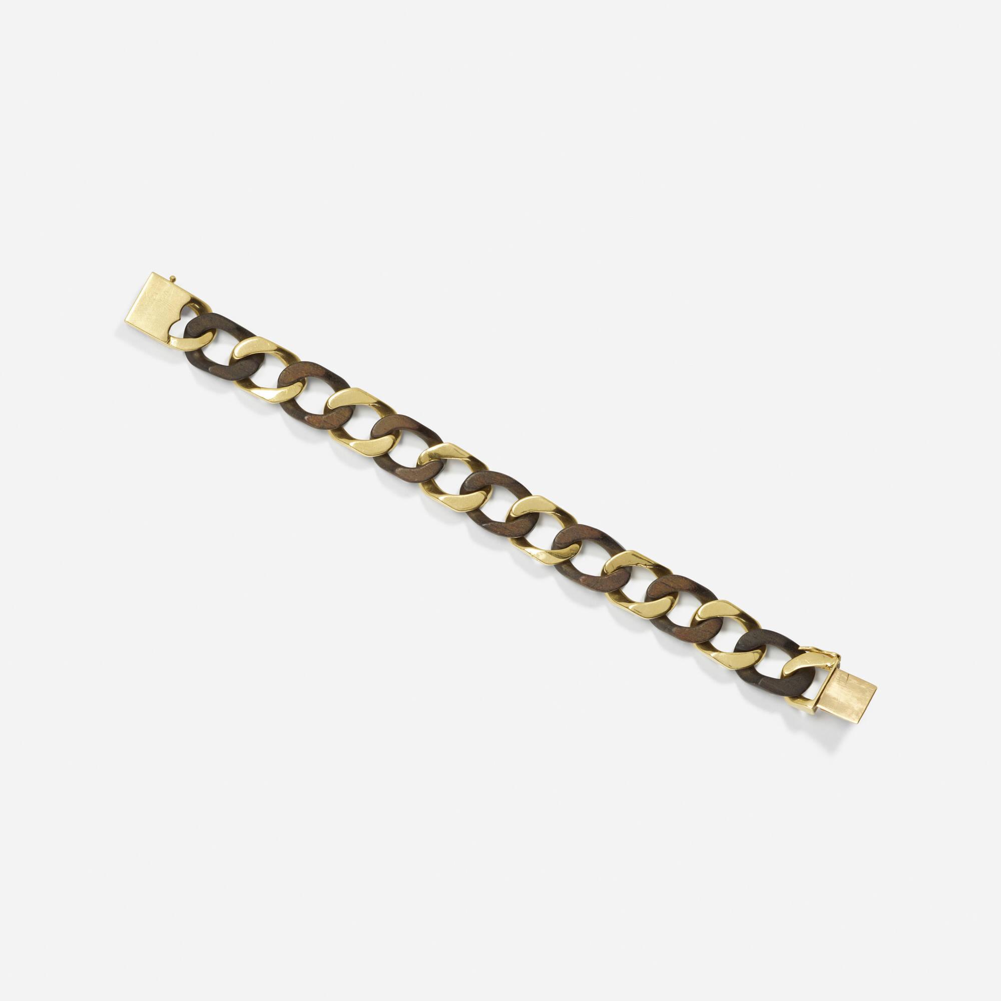 159: Van Cleef & Arpels / A gold and wood bracelet (1 of 1)