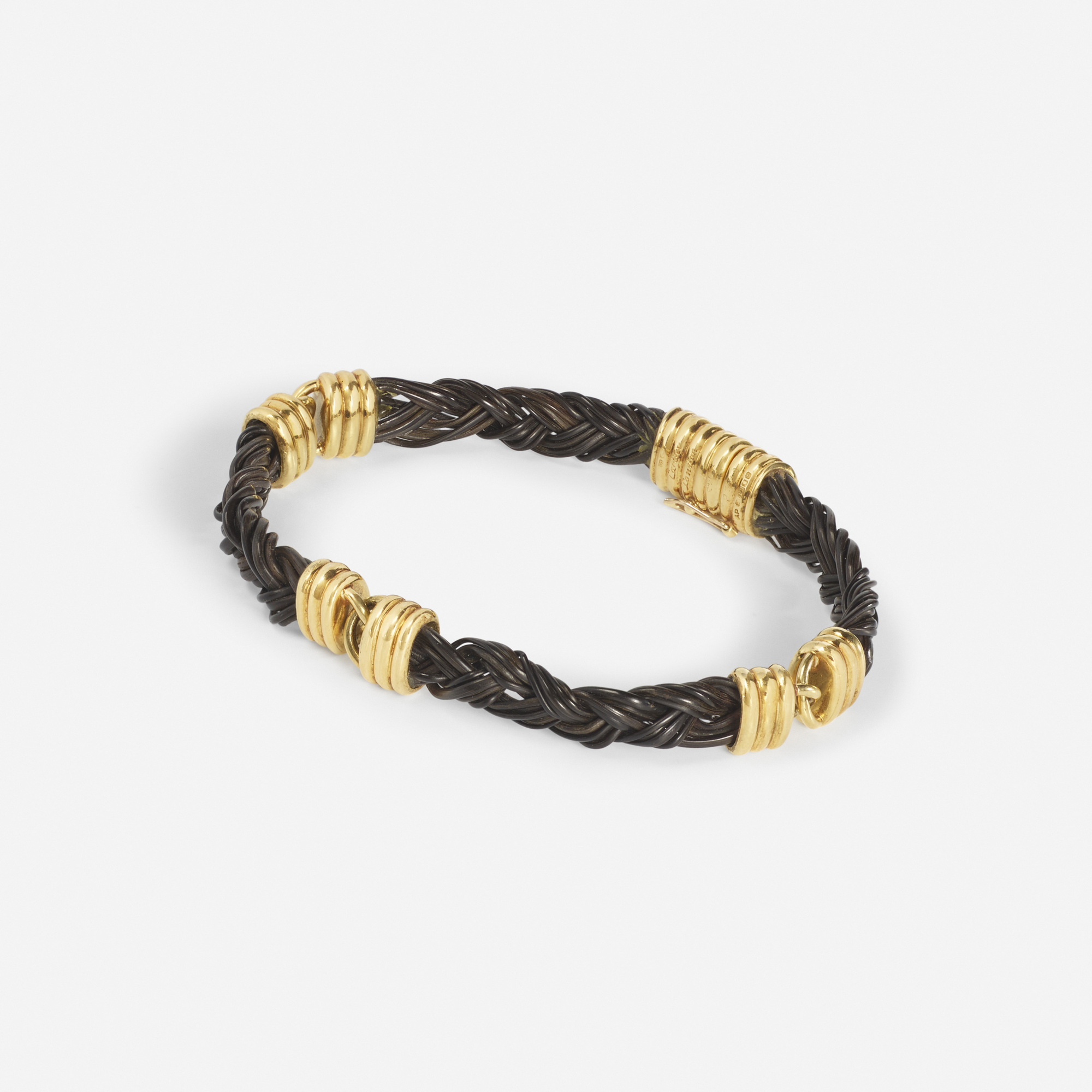162: Cartier / A gold and elephant hair bracelet (1 of 2)