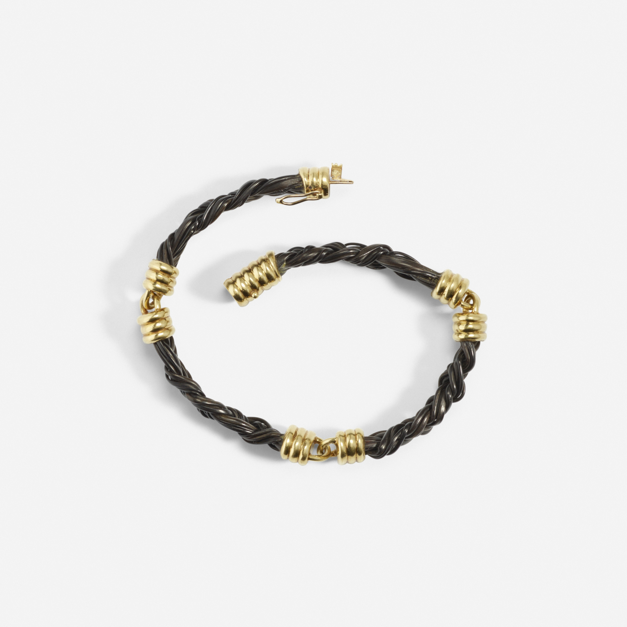 162: Cartier / A gold and elephant hair bracelet (2 of 2)