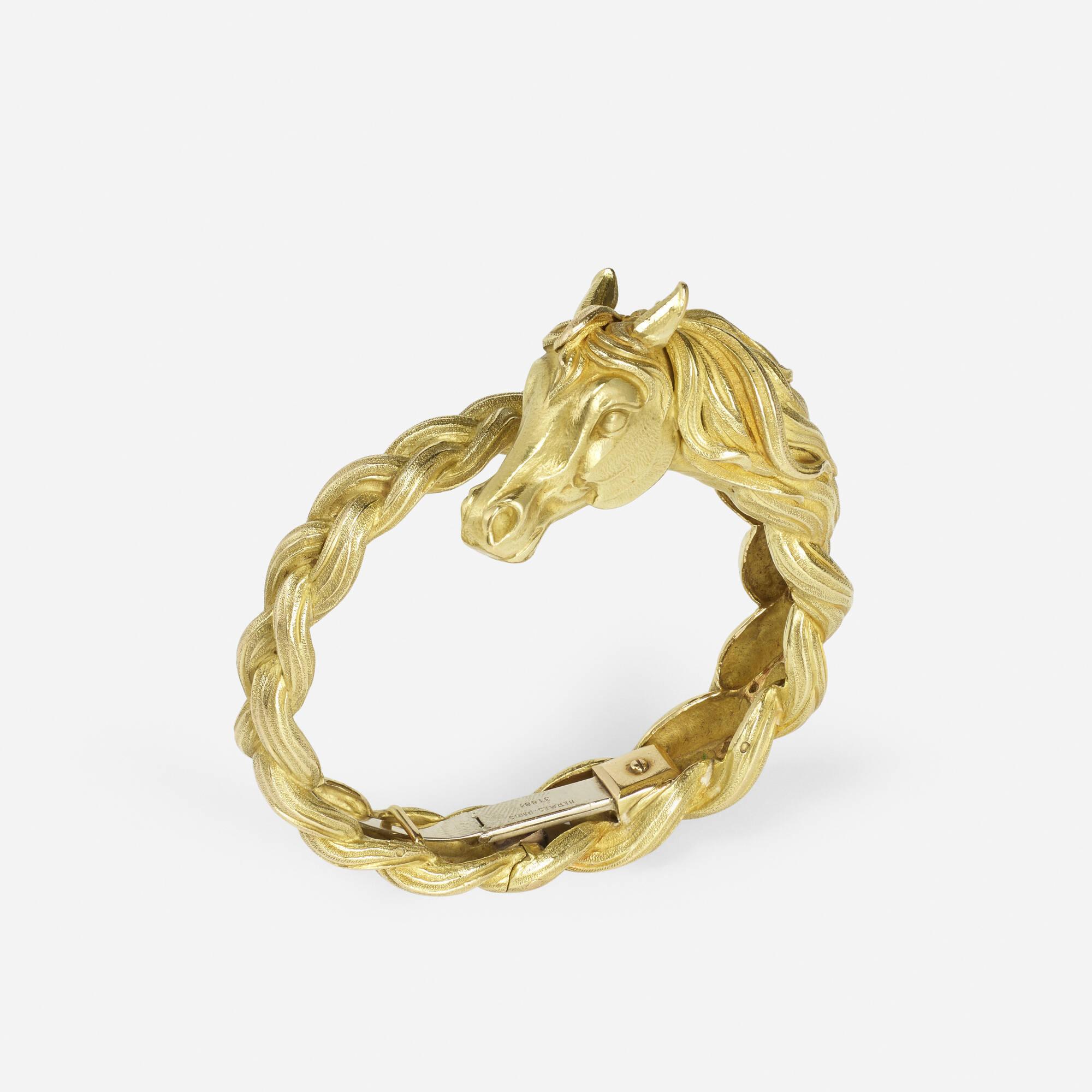 165: Hermès / A gold Tête de Cheval bracelet (1 of 2)