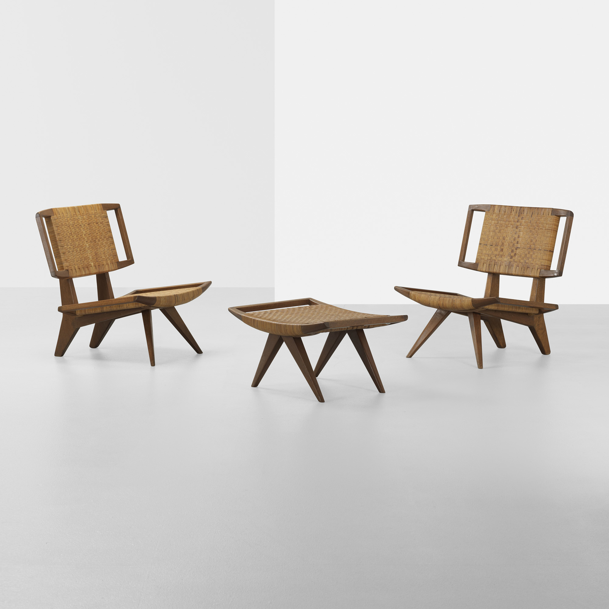 229: Paul Laszlo / pair of lounge chairs and ottoman (1 of 3)