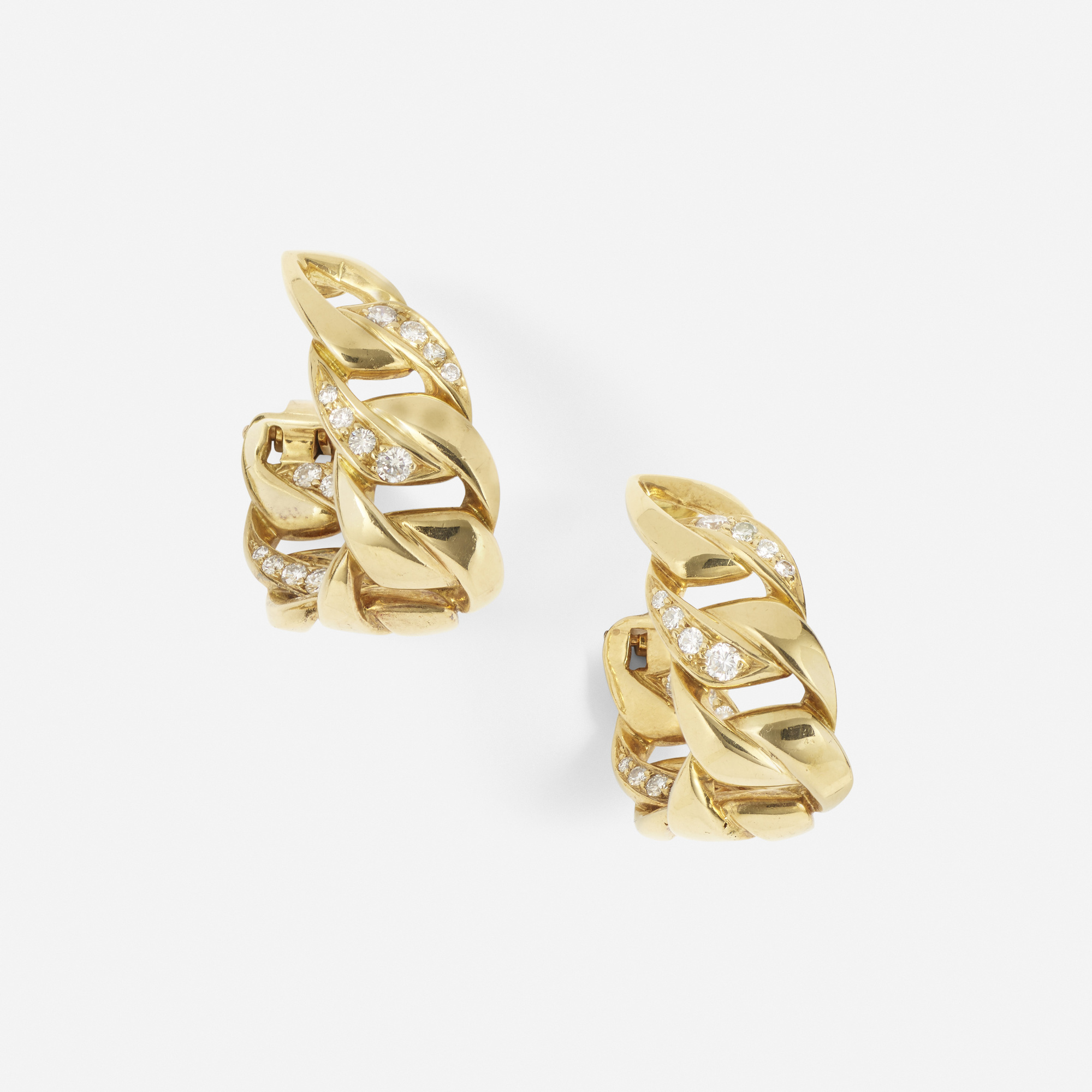 252: Cartier / A pair of gold and diamond earrings (1 of 2)
