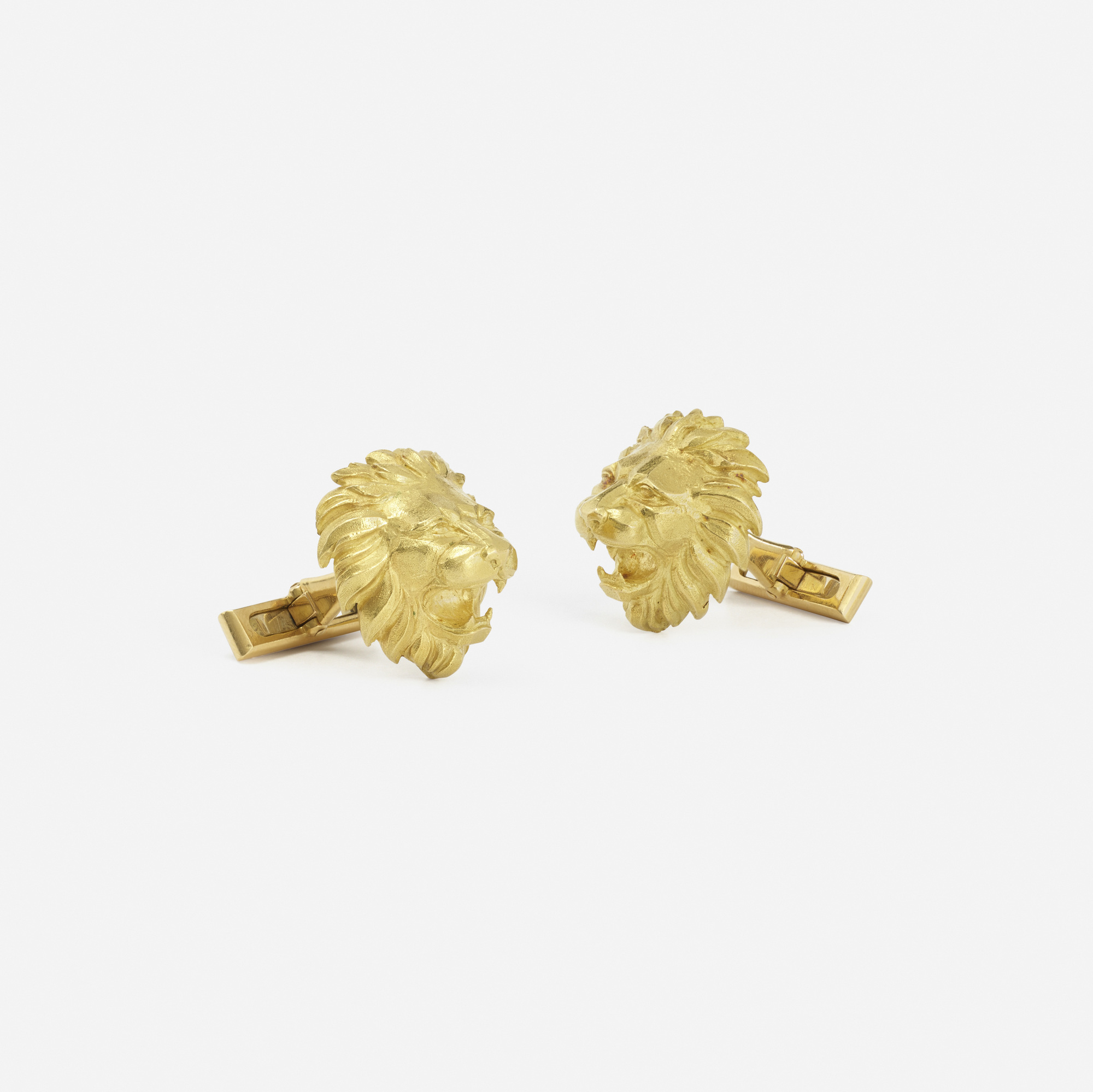 259:  / A pair of gold Lion cufflinks (2 of 2)