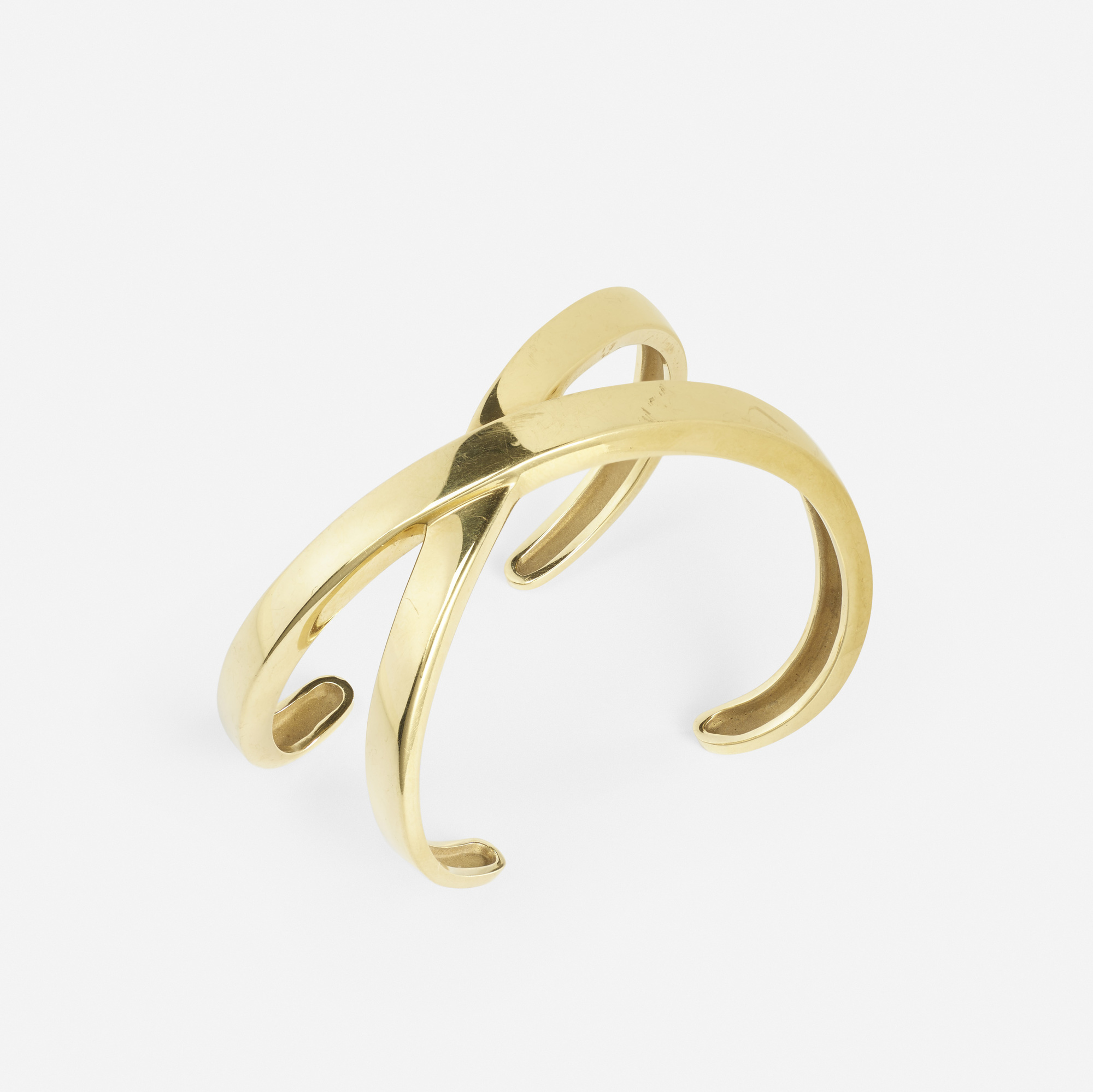 265: Paloma Picasso for Tiffany & Co. / A gold bangle from the X Collection (1 of 2)