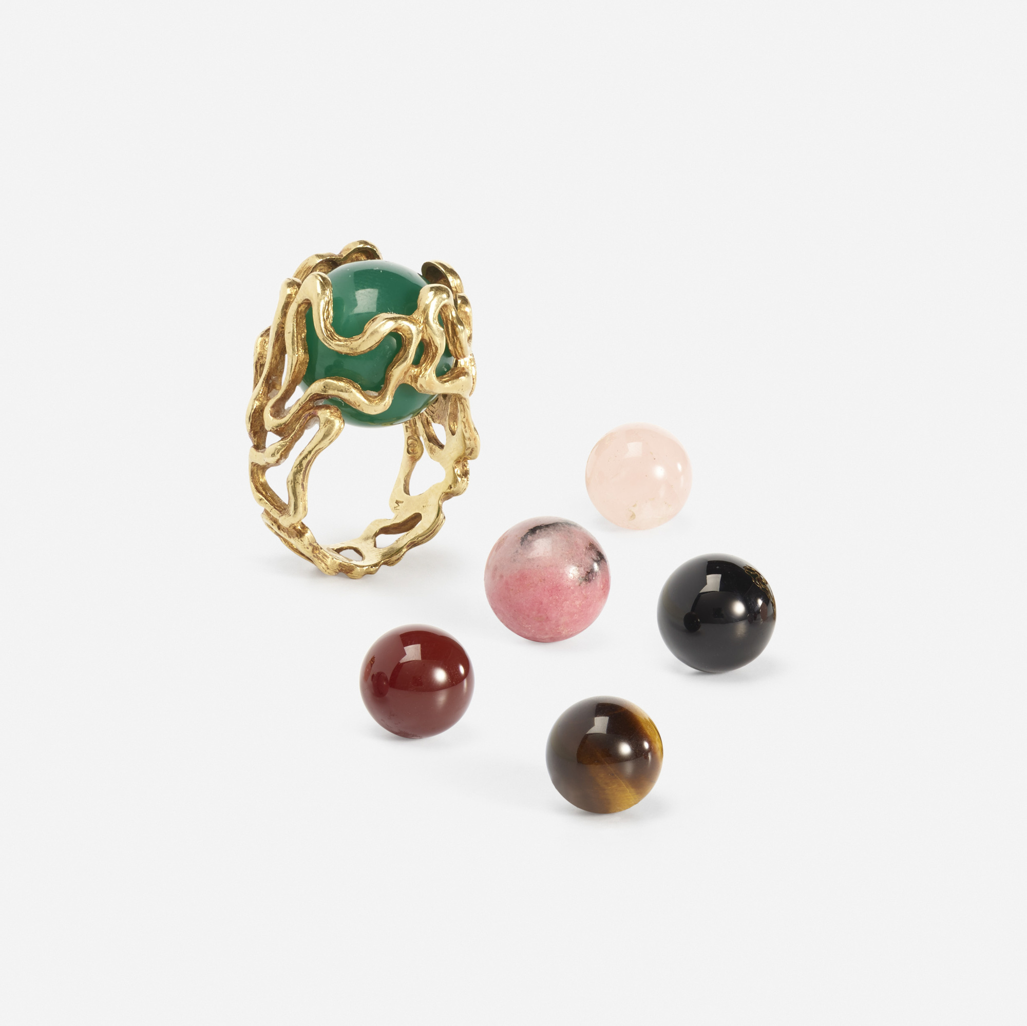 285: GILBERT ALBERT, A gold ring with interchangeable gemstones ...